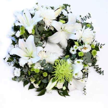 white and green wreath for funeral service